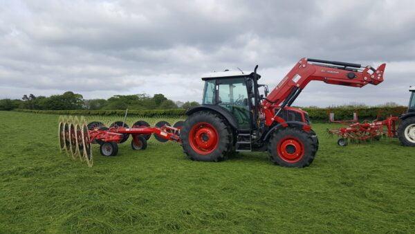 Enorossi Batrake V-Rake behind Armatrac Tractor in UK and Ireland