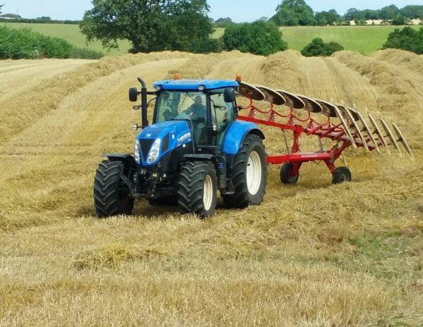Enorossi Batrake V-Rake behind New Holland Tractor in UK after raking up straw