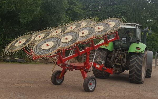 Enorossi Batrake V-Rake in transport position in UK behind a Deuz Tractor
