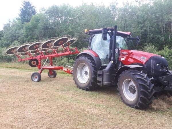 Enorossi V-Rake raking behind a Case Tractor
