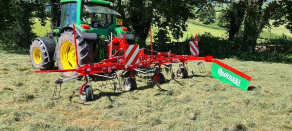 Enorossi Vortex 4 Rotor Tedder working with Headland Kit in the UK and Ireland static image
