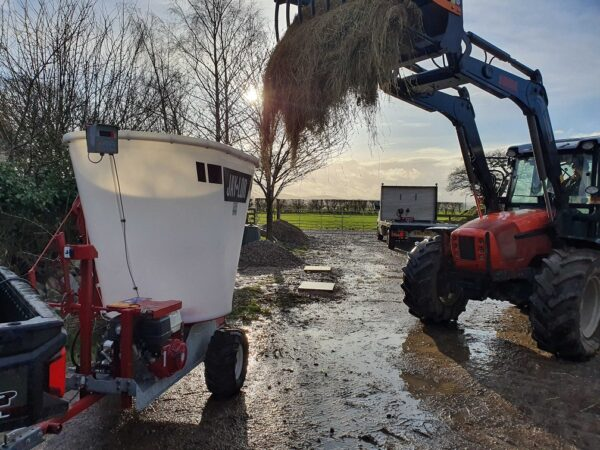 Jaylor A5050 Trailed Mini Mixer Wagon being filled up with Tractor Grab