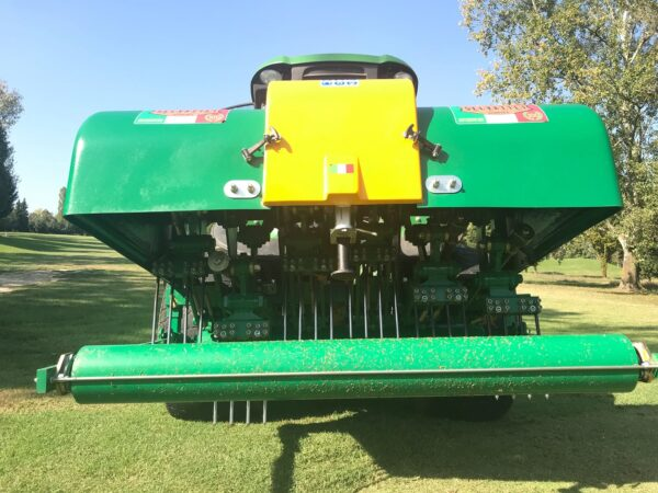 Selvatici Aeroking 300.80 working on a John Deere Tractor on a Golf Course close up from behind machine